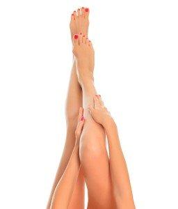 Long female legs on white background