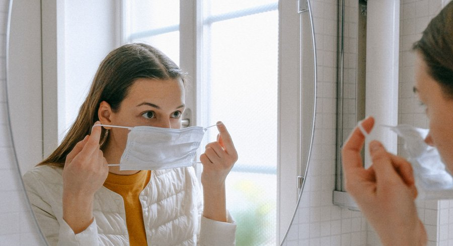 woman putting a mask on